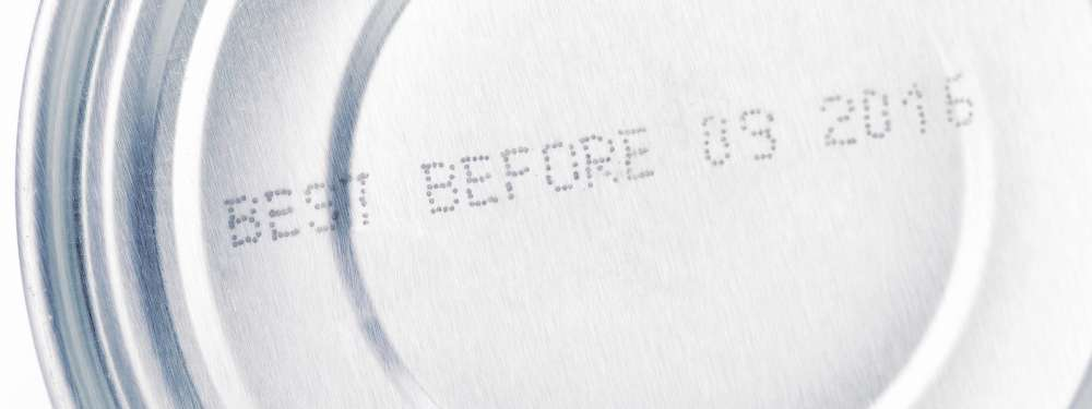"""A closeup of a best-by date on the bottom of a tin can. The text reads: """"Best Before 09 2016."""""""